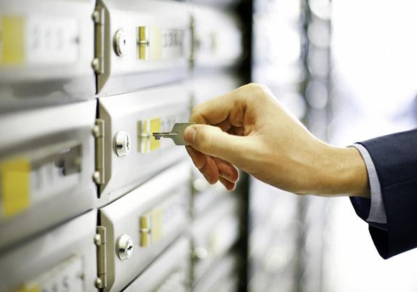 Man opening mailbox